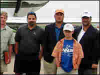 Various Capitol Hill figures pose in front of the private jet they took for a golf outing