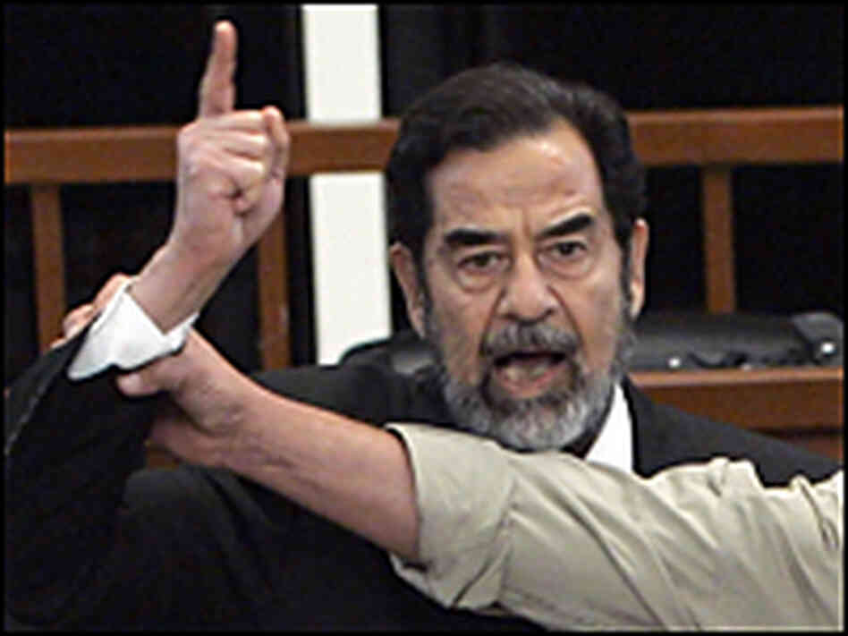 Saddam Hussein yells at the court as he receives his death sentence.