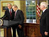 President Bush joins Defense Secretary Donald Rumsfeld in the Oval Office. Robert Gates is at right.