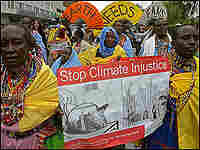 Maasai protesters in Kenya hold placards during a march appealing for urgent action to fight clima