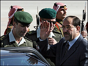 Iraqi Prime Minister Nouri al-Maliki waves as he arrives in Amman for a summit with President Bush.