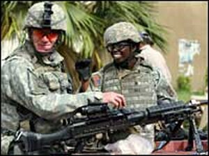 U.S. soldiers man a checkpoint in central Baghdad, Oct. 29, 2006.