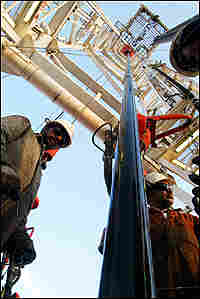 A Kuwait Oil Company drilling rig operates on the northern border with Iraq.