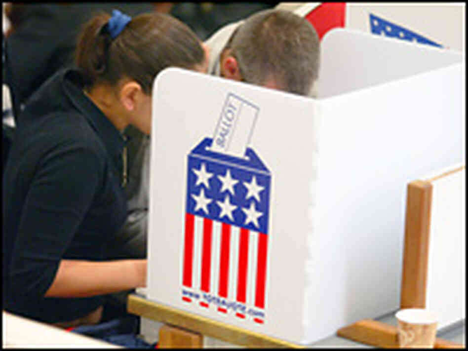 Oregon voters cast their ballots in the 2004 elections.