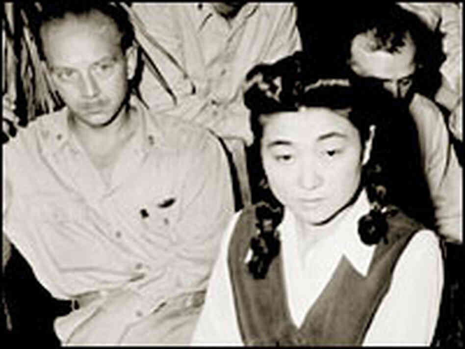 Reporters interview Iva Toguri D'Aquino in September 1945.