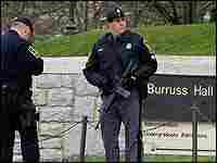Police stand watch at Virginia Tech.