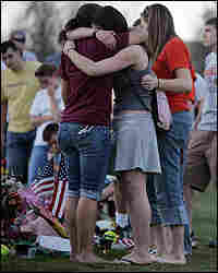 Mourners gather Sunday at a makeshift memorial on the Virginia Tech campus.