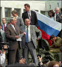 Boris Yeltsin stands atop an armored personnel carrier in Moscow in 1991.