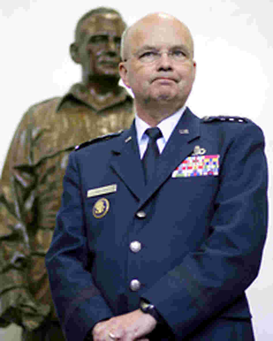 Central Intelligence Agency Director Gen. Michael Hayden in front of a statue of William Donovan.