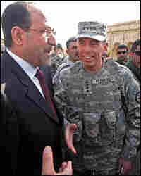 U.S. Gen. David Petraeus and Iraqi PM Nouri al-Maliki. Credit: PATRICK BAZ/AFP/Getty Images.