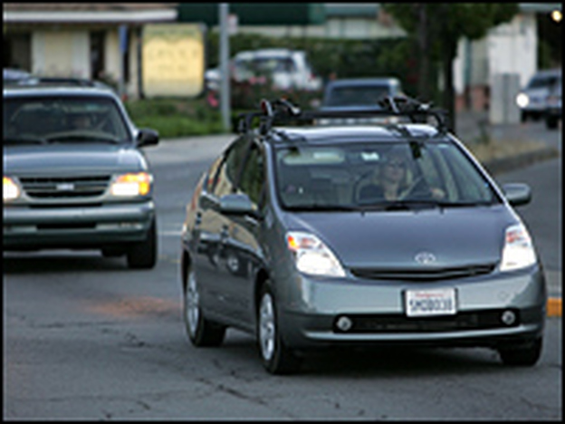Myself, My Car: A Toyota Prius hybrid is seen driving down the street in San Anselmo, Calif.