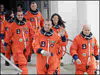 Astronauts make their way to the launch pad/AP.