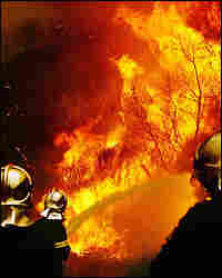 Firemen battle a fire near the village of Andritsena at Pelloponese peninsula, Aug. 27, 2007.