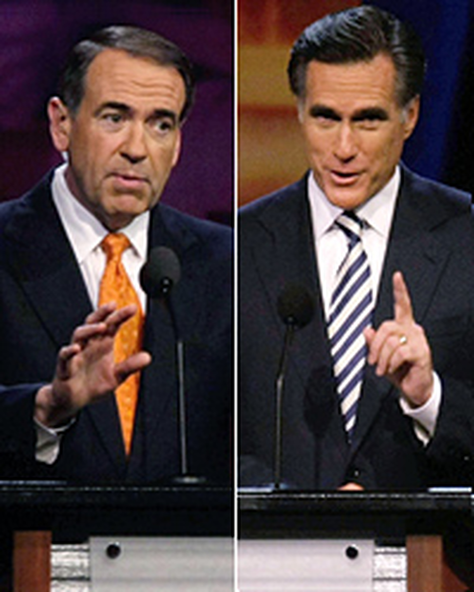 Republican presidential candidates former Arkansas Gov. Mike Huckabee (left) and former Massachusetts Gov. Mitt Romney speak during the Univision Republican forum in Miami, Fla.