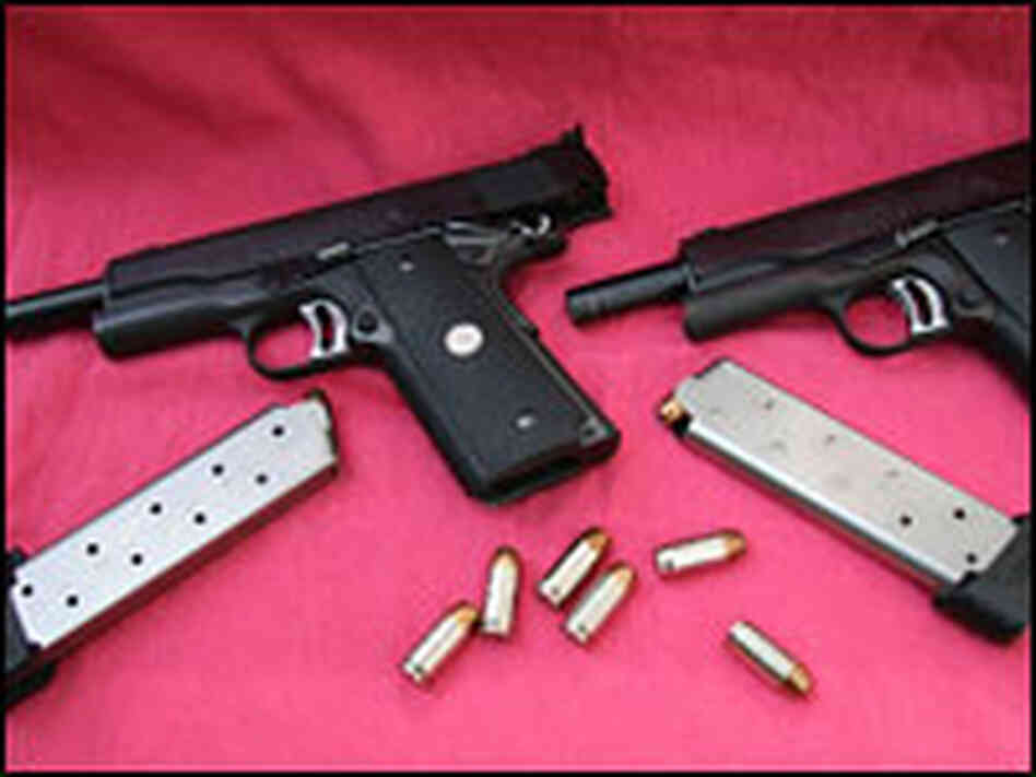 Colt .45 semiautomatic pistols with ammo and clips.