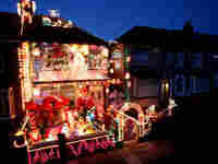 Christmas decorations and lights adorn a house.