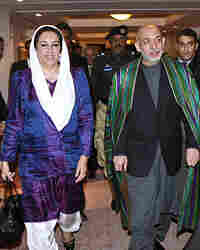 Former Pakistani Prime Minister Benazir Bhutto is seen with Afghan President Hamid Karzai after a me