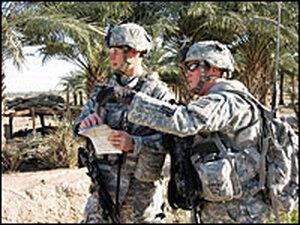 First Lt. Allen Von Plinsky (left) and Pfc. Scott Carlblom examine a map in Babil province, Iraq.