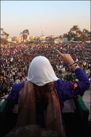 Former Pakistani Prime Minister Benazir Bhutto addresses supporters at a campaign rally.