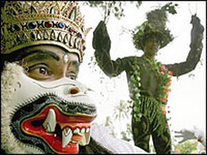 Pande Beratha (R), dressed as a tree, takes part in an anti-deforestation campaign.