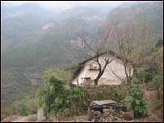 One of the farmhouses awaiting destruction on the banks of the Three Gorges Reservoir in Miaohe village, Zigui county, Hubei province. The government is relocating residents following a spate of landslides this year.