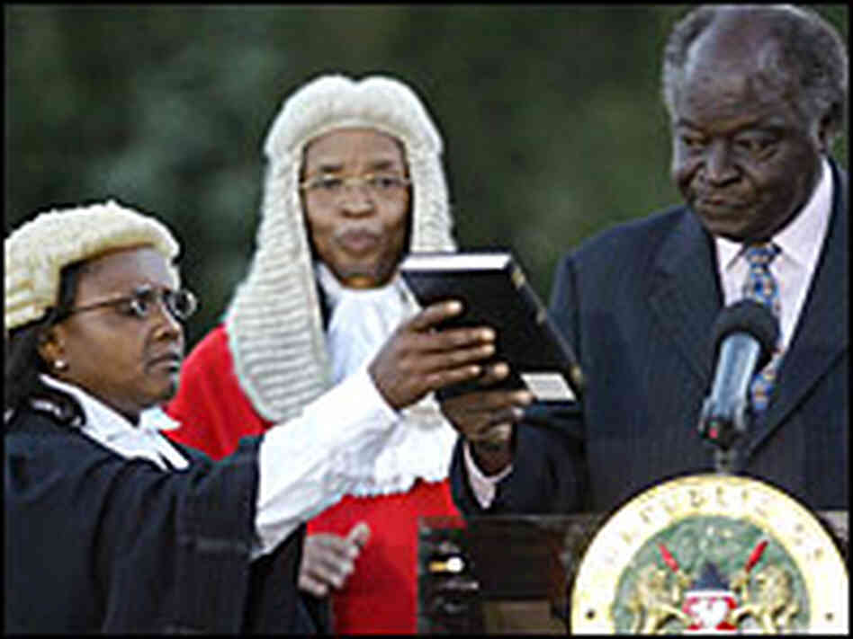 Newly re-elected Kenya President Mwai Kibaki (R) is sworn in for a second term on Sunday.