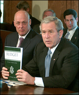 President Bush discusses his new budget plan, with Secretary of the Treasury Henry Paulson (left)