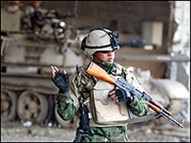 An Iraqi army soldier mans a checkpoint in Baghdad.