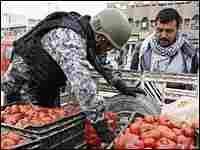 Iraqi police commando searches truck in Baghdad