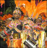 Members of the Salgueiro Samba School march in a Carnival parade.