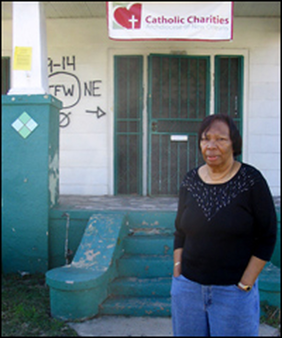 Ethel Williams stands in front of her house on Pauline Street. Despite two visits by President Bush, her property risks being condemned.