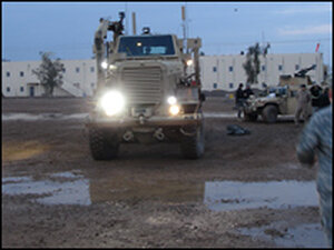 The 875th's Buffalo, an armored mine-disposal vehicle. Its articulating arm is folded back.