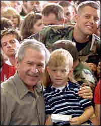 President Bush poses for photographs n Martinsburg, West Virginia.