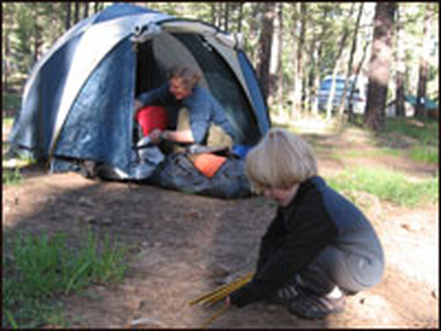 Jonathan Overpeck and son Jackson, 5, set up camp during the family's trip to explore the effects of drought on the Southwest.