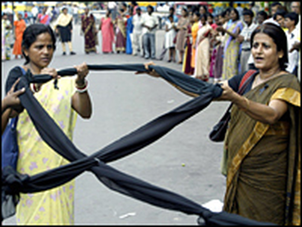 Indian activists hold a black ribbon as they take part in an HIV awareness rally in June.