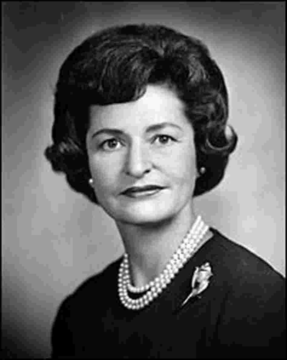 Headshot of Lady Bird Johnson wearing a pearl necklace and a brooch