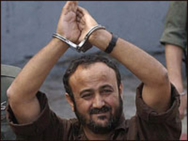 Palestinian West Bank Fatah leader Marwan Barghuti walks into a Tel Aviv court in May 2004.