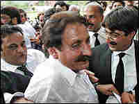 Jubilant lawyers surround the reinstated chief justice.