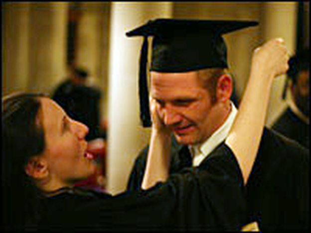 Katie Bishop adjusts husband Chris' cap at their graduation from seminary in May 2007.  They are now Methodist ministers in rural Maryland.