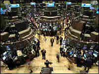 Traders work on the floor of the NYSE moments before the closing bell July 19, 2007.