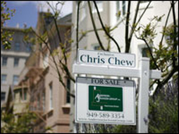 A sign stands in front of a home for sale in San Francisco, June 2007. The foreclosure rate in the city's suburbs has tripled in the last year.