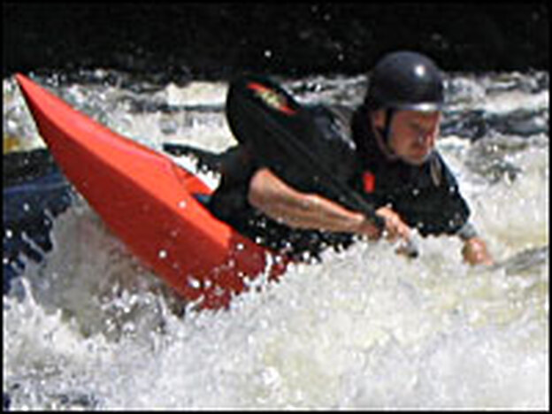 Dan McDonald kayaking on Maine's Penobscot River.  McDonald and his wife run their own whitewater rafting company, Penobscot Adventures.