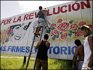 """A billboard reading in Spanish """"For the revolution,"""" in Cuba/AP."""