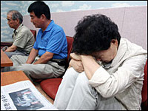 Relatives of the kidnapped South Koreans/Getty.
