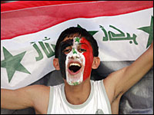An Iraqi fan cheers for his team before the start of the final match of the Asian Football Cup 2007 between Iraq and Saudi Arabia at the Bung Karno stadium in Jakarta on Sunday.