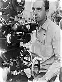 Michaelangelo Antonioni behind the camera in 1965.
