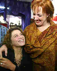 American hairdresser Debbie Rodriguez (R) hugs a student beautician at the Kabul Beauty