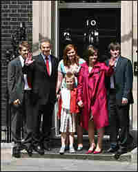 Blair bids farewell to the media with his family
