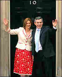 Gordon Brown, the new prime minister of Britain, and his wife Sarah wave to the media.