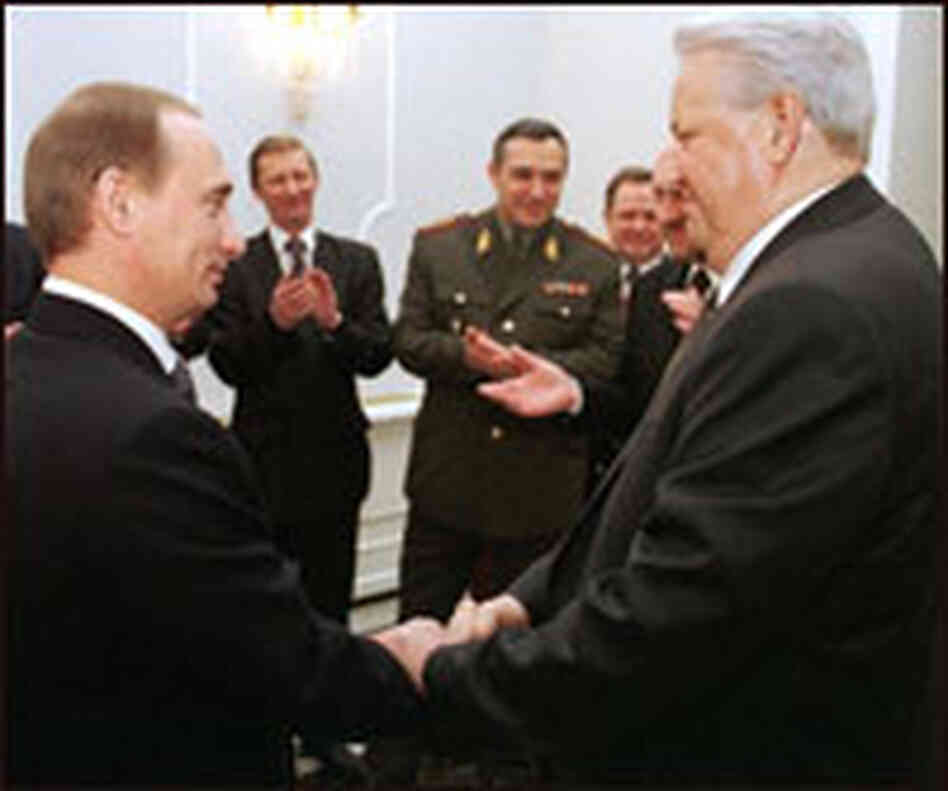 Outgoing Russian President Boris Yeltsin, right, shakes hands with Prime Minister Vladimir Putin.